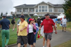 Fans head out to the 18th to await the field